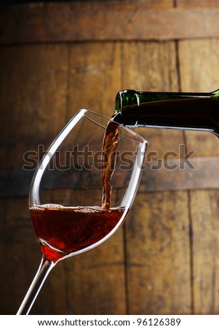 glass of wine  with barrel