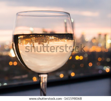 Glass of wine with city view