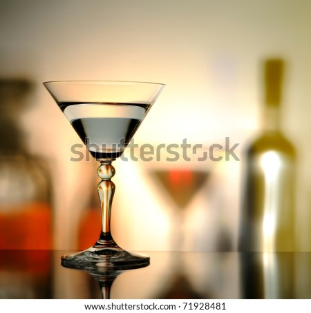 glass on a background with the shadows of bottles - stock photo