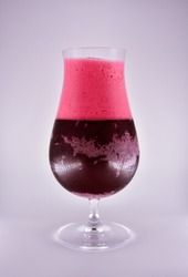 glass on a white background, a glass with cherry beer, glass with red liquid and foam, filled with glass goblet on a leg
