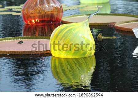 Glass Ornaments Floating in Water Stock foto ©