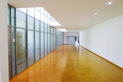 Glass partitions in the corridor of the office. Modern and harmonious design of office interior.