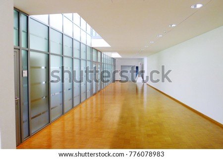Glass partitions in the corridor of the office. Modern and harmonious design of office interior. #776078983