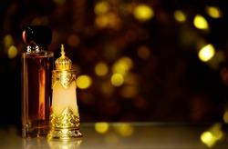 glass perfume bottle dark background