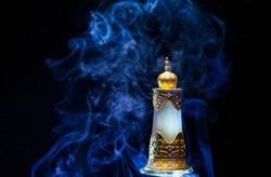 glass perfume bottle smoke dark background