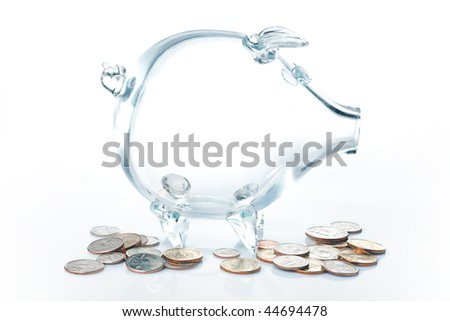 Glass piggy-bank with dollars against a white background