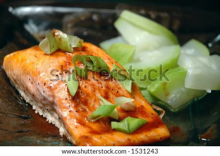 Glass plate with a steelhead trout fillet and steamed summer squash