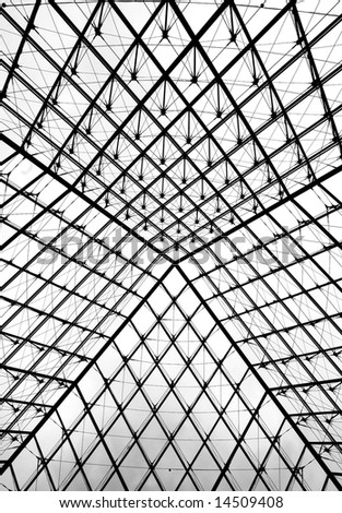 Glass pyramid entrance to the Louvre museum in Paris. Shot form the entrance floor up to the sky.