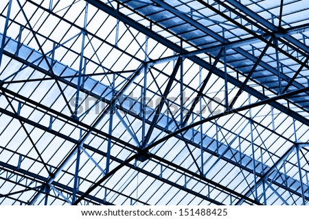 Glass roof of industrial building, toned in blue - Shutterstock ID 151488425