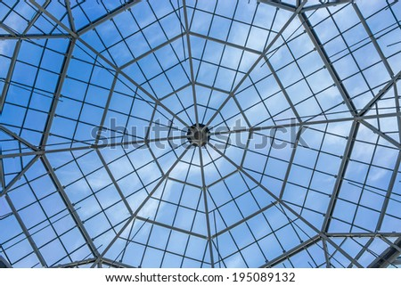 Glass roof of the building over blue sky #195089132