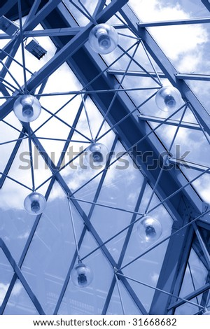 Glass roof of the modern pedestrian crossing. Tint blue