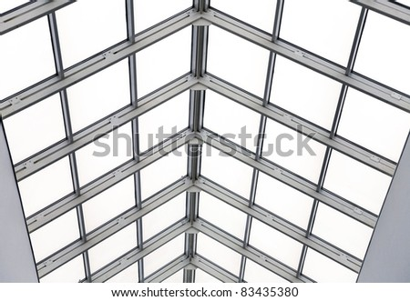 Glass roof with metal frames in an interior of modern office | EZ Canvas