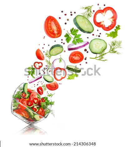 glass salad bowl in flight with vegetables: tomato, pepper, cucumber, onion, dill and parsley. Isolated on white background #214306348