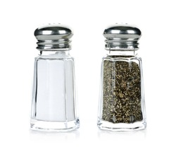 Glass salt and pepper shakers isolated on white background