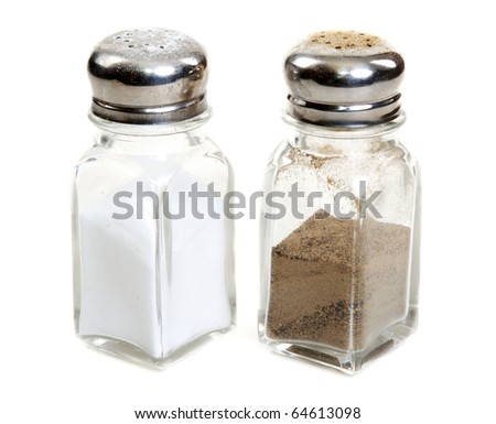 Glass saltcellar and pepper shaker on white background