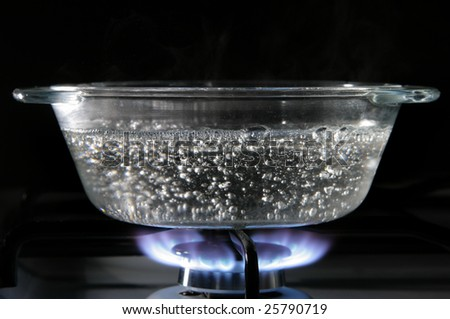 Glass saucepan on the gas stove close-up