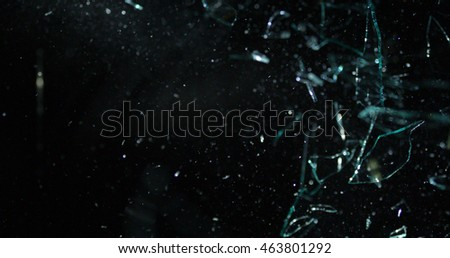 Glass shards flying through the air after broken window