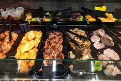 glass showcase with meat delicacies in it
