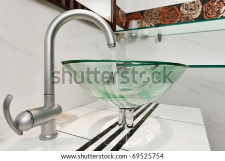 Glass sink bowl in modern minimalism bathroom interior - stock photo