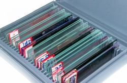 Glass slides stack into the slide box, angle view