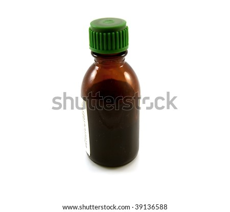 Glass small bottle of medicines of brown colour isolated on a white background