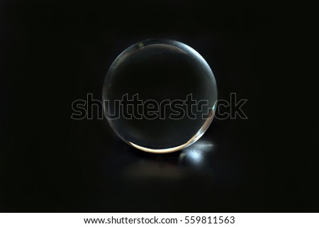 Glass spear ball globe transparent on black background  #559811563