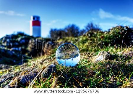 glass sphere and lighthouse #1295676736