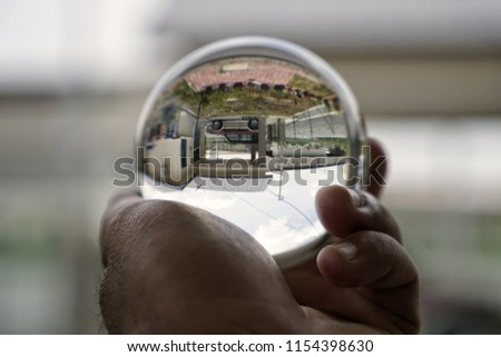 Glass sphere in hand #1154398630