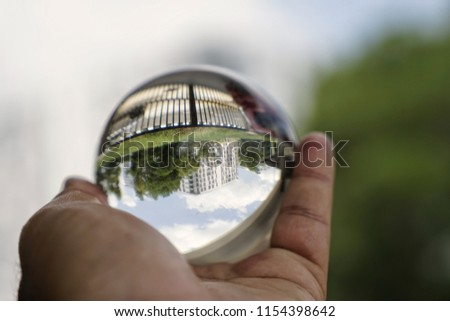 Glass sphere in hand #1154398642