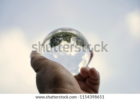 Glass sphere in hand #1154398651