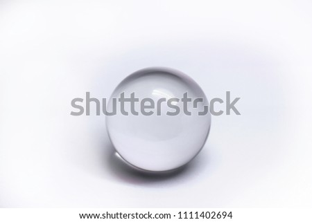 Glass sphere on White background #1111402694