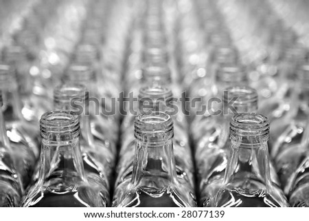 Glass square transparent bottles, factory lines and rows