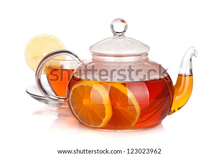 Glass teapot and cup of black tea with lemon. Isolated on white background