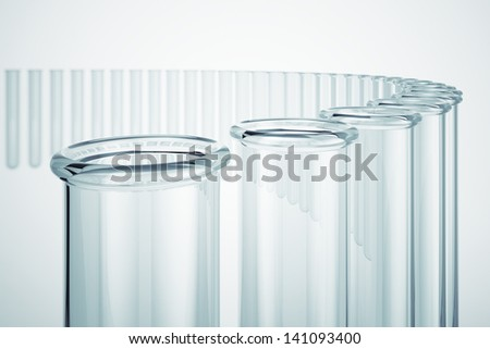 Glass test tubes on a white backgroud. Test tubes are used by chemists to hold, mix or heat different chemicals. Perfect for medical, chemical and research theme backgrounds.