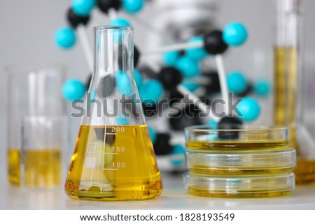 Glass test tubes with yellow viscous liquid stand on table in chemical laboratory closeup. Checking the quality of petroleum products refining concept. Сток-фото ©