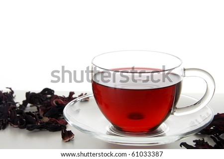 Glass Transparent Cup of Karkadeh Red Tea with Dry Flowers