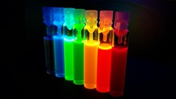 Glass tubes with quantum dots of perovskite nanocrystals, luminescing with all colors of the rainbow under ultraviolet radiation