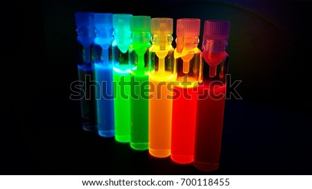 Glass tubes with quantum dots of perovskite nanocrystals, luminescing with all colors of the rainbow under ultraviolet radiation #700118455