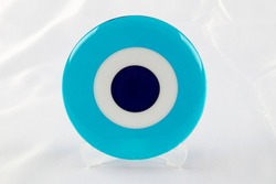 Glass Turkish eye on white background Evil eye amulet protect from bad things using by turkish culture.