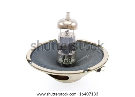 glass vacuum radio tube and speaker isolated on white background
