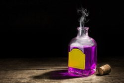 Glass vial with a purple potion on a dark background. Magic elixir. Copy space for text. 3D rendering