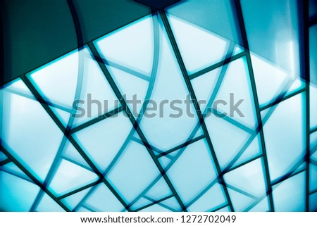 Glass wall / ceiling with curvilinear metal framework. Reworked photo of transparent modern architecture fragment. Abstract background image on the subject of industry or technology.