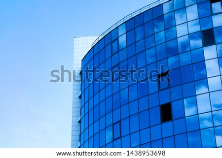 Glass wall facade with cloud sky reflection. Modern urban architecture background. Skyscraper business center, bank or hotel in city downtown. Glassy megalopolis exterior #1438953698