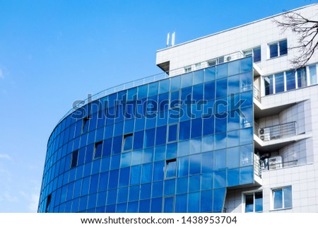 Glass wall facade with cloud sky reflection. Modern urban architecture background. Skyscraper business center, bank or hotel in city downtown. Glassy megalopolis exterior #1438953704