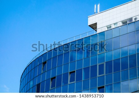 Glass wall facade with cloud sky reflection. Modern urban architecture background. Skyscraper business center, bank or hotel in city downtown. Glassy megalopolis exterior #1438953710