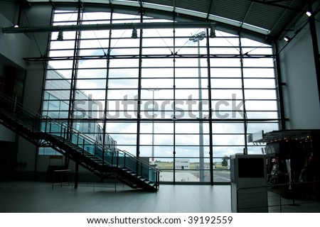 Glass wall in international airport lounge interior