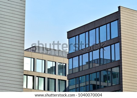 Glass walls of a office building - business background #1040070004