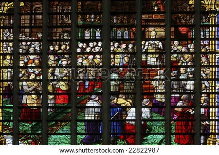 Glass window in the Saint Rumboldts cathedral of Mechelen, Belgium. The window depicts the reading of the dogma of the immaculate conception of Maria by the pope and was fabricated in Mechelen in 1860
