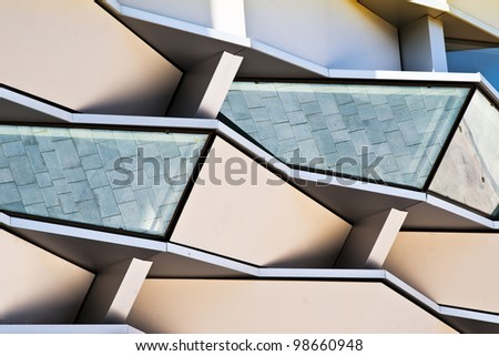 glass windows in front of modern building, located in Zaragoza, Spain.