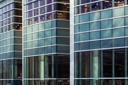 Glass windows of contemporary building (library) form abstract background pattern